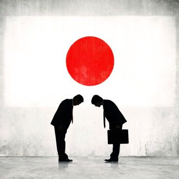 Two Japanese Business Person Greeting with Japanese Flag